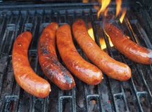 Sausages on a grill Stock Photo