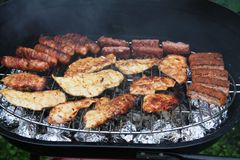 Sausages on grill Royalty Free Stock Photography