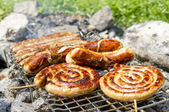 Sausages on grill outdoor Stock Photography