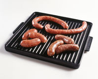 Sausages on a grill pan Stock Photography