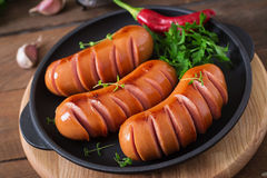 Sausages on the grill. Stock Photo
