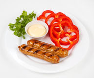 Sausages a grill Royalty Free Stock Images