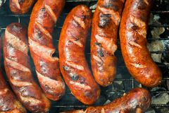 Sausages on the grill Royalty Free Stock Photos