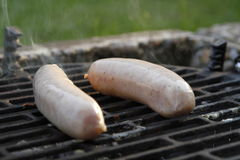 Sausages on grill Stock Photo