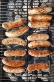 The sausages on the grill. Royalty Free Stock Photo