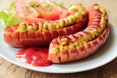 Sausages grilled on barbecue Stock Image