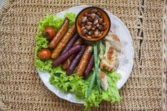 sausages and grilled chicken breast from above Royalty Free Stock Images