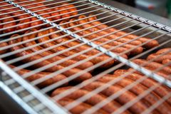 Sausages are grilled. Cooking sausages barbecue. Fast food. Lattice BBQ stock photo