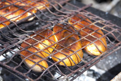 Sausages grilled. Fried tasty and crunchy grilled sausages on the grill Royalty Free Stock Image