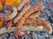 Sausages grilled on portable barbecue outdoor Royalty Free Stock Images