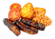 Sausages And Grilled Tomatoes With Hash Browns Royalty Free Stock Photo