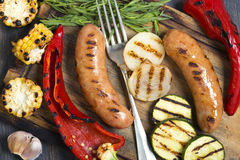 Sausages and grilled vegetables closeup. Royalty Free Stock Photo