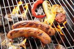 Sausages and grilled vegetables on the grill close up Royalty Free Stock Photo