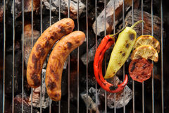 Sausages and grilled vegetables on the grill close up Royalty Free Stock Images