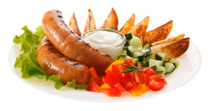Sausages grilled with vegetables and sauce on the plate. Isolate. D on white background Royalty Free Stock Photos