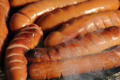 Sausages grilling process Royalty Free Stock Photo