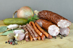 Sausages. A group of sausages with spices Royalty Free Stock Image
