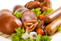 Sausages and ham. With lettuce, garlic and tomatoes Royalty Free Stock Image