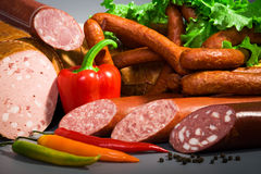 Sausages and ham Stock Photography