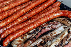 Sausages and ham with fried bacon Stock Images