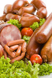 Sausages and ham with lettuce and tomatoes Royalty Free Stock Images