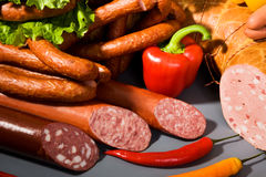 Sausages, ham and peppers Royalty Free Stock Photos