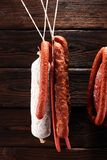 sausages hang from a rack at market. Country dark style. Traditional food. Smoked sausages meat hanging royalty free stock image