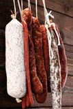 sausages hang from a rack at market. Country dark style. Traditional food. Smoked sausages meat hanging stock images
