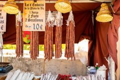 Sausages hanging at the medieval market of Valencia, Spain stock photo