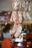 Sausages hanging to mature in a butcher. Sausages hanging to mature in an Italian butcher Royalty Free Stock Images