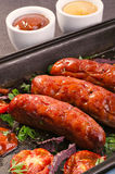 Sausages and ingredients. Royalty Free Stock Image