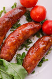Sausages and ingredients. Stock Photos