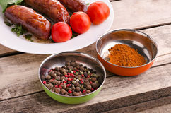 Sausages and ingredients. Royalty Free Stock Images