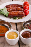 Sausages and ingredients. Royalty Free Stock Photo
