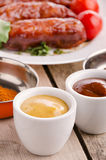 Sausages and ingredients. Stock Photography