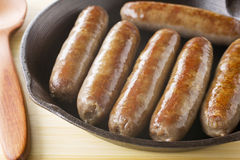 Sausages in an Iron Skillet Stock Image