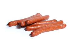 Sausages isolated on white. Tasty hot sausages isolated on white royalty free stock image