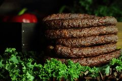 Sausages kabanos. Arranged among greens Royalty Free Stock Photography