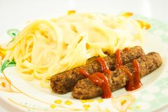 Sausages With Ketchup and Pasta Stock Photo