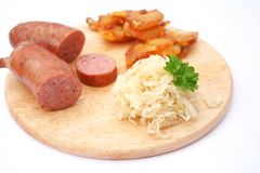 Sausages with kraut and potatoes Royalty Free Stock Images