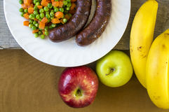 Sausages for lunch and bananas for dessert Stock Images