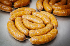 Sausages. Manufacture of meat sausages raw Royalty Free Stock Photo