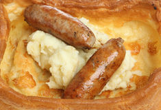 Sausages & Mash in Yorkshire Pudding Stock Images