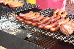 Sausages and meat on the BBQ grill Stock Image