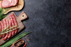 Sausages and meat cooking Stock Images