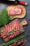 Sausages and meat cooking royalty free stock images
