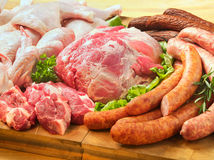 Sausages and meat on a cutting board Royalty Free Stock Photos