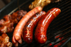 Sausages and meat on the grill-barbecue Royalty Free Stock Photography