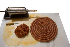 Sausages and meat for sausages. Tools, raw materials and finished product Royalty Free Stock Images