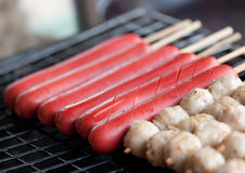 Sausages and meatballs on grill Royalty Free Stock Images